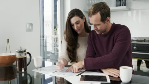 They understand the importance of financial security 4k video footage of a young couple going over their personal finances while sitting in the kitchen bonding stock videos & royalty-free footage