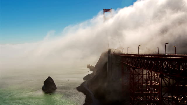 a thick fog rolls over the golden gate bridge in the san francisco bay. - travel agent stock videos and b-roll footage
