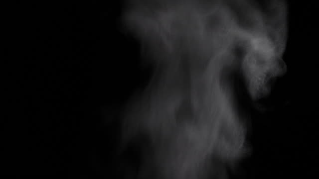Thick hot steam on a black background Steaming hot smoke is moving up agains a black studio background. Shot in 4K resolution. steam stock videos & royalty-free footage