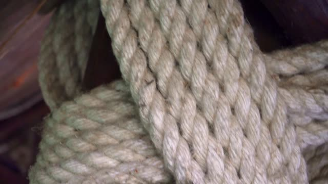 thick rope wrapped around a wooden log