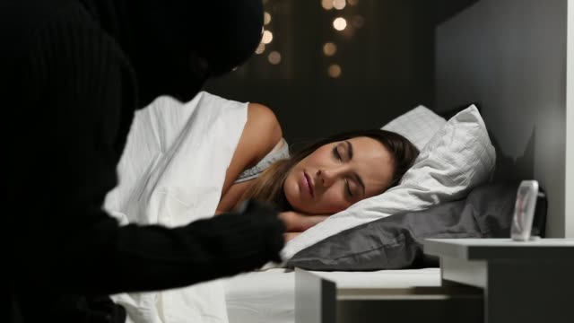 stockvideo's en b-roll-footage met dief stelen terwijl de huiseigenaar is slapen - alarm, home,