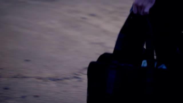 vídeos de stock e filmes b-roll de thief throwing bag with money in car trunk and driving away, bank robbery - roubar crime
