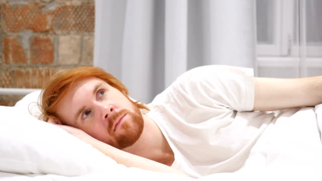 Thinking, Pensive Man Lying on Side and Dreaming while in Bed video