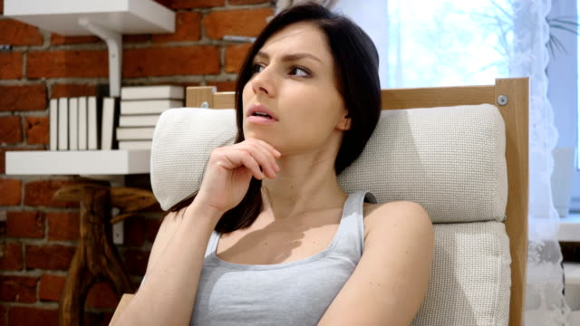Thinking Pensive Woman Sitting at home, Brainstorming video