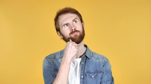Thinking Redhead Man Got New Idea Isolated on Yellow Background