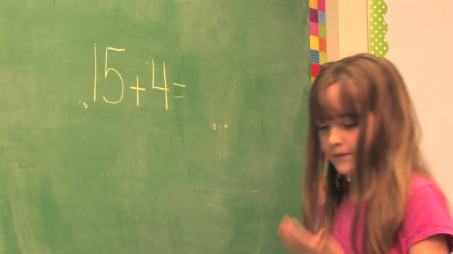 Third-Grade Math (HD) Eight-year-old girl demonstrates her math skills on the chalk board in an elementary school classroom.  elementary age stock videos & royalty-free footage