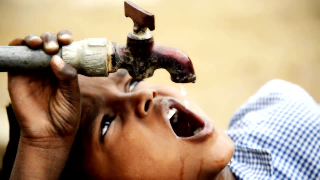 Thirsty - Stock Video Rural boy drinking water poverty stock videos & royalty-free footage