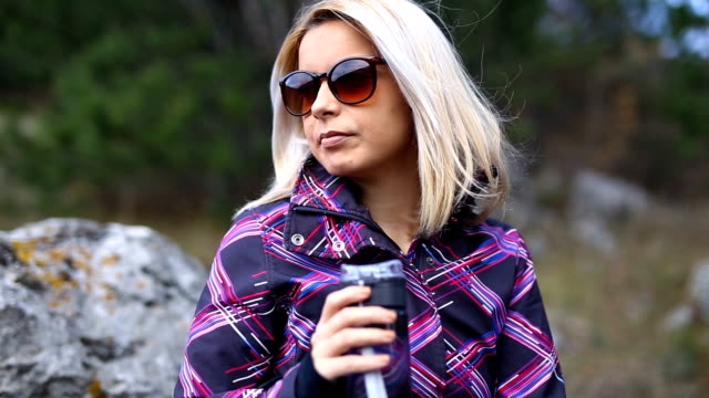 Thirsty woman in nature drinking water video