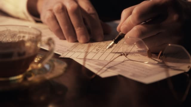 thirties businessman closeup writing 4k Close up scene of the hands of a 1930s businessman with fountain pen making entries into a ledger. 20th century stock videos & royalty-free footage