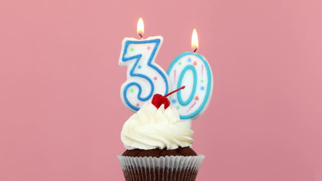 Thirty 30 candle in cupcake pink background video