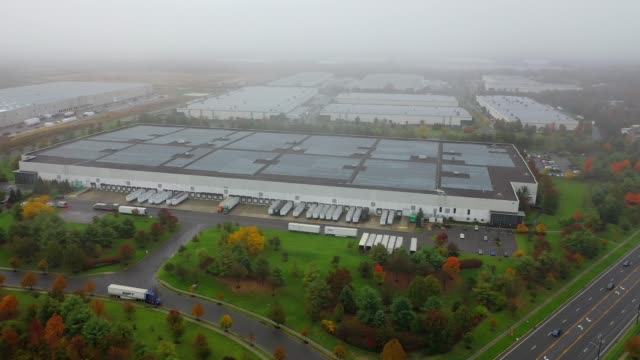 This is an aerial shot of a 1 million square foot warehouse. This is an aerial shot of a 1 million square foot warehouse near Monroe, NJ. warehouse aerial stock videos & royalty-free footage