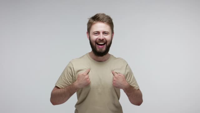 This is me! Happy excited bearded man feeling very proud pointing himself, shouting introducing best person