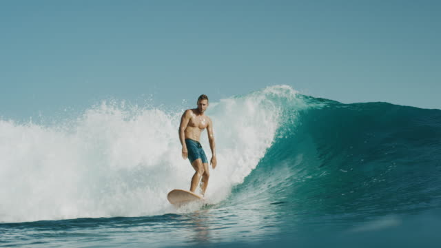 This man surfs with style