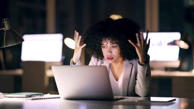 This slow internet connection will be the death of me 4k video footage of a young businesswoman looking frustrated while working on a laptop in an office at night emotional stress stock videos & royalty-free footage
