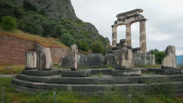 Tholos with Doric columns at the Athena Pronoia temple ruins in Delphi, Greece Tholos with Doric columns at the sanctuary of Athena Pronoia temple ruins in ancient Delphi, Greece. Dolly shot greek architecture stock videos & royalty-free footage