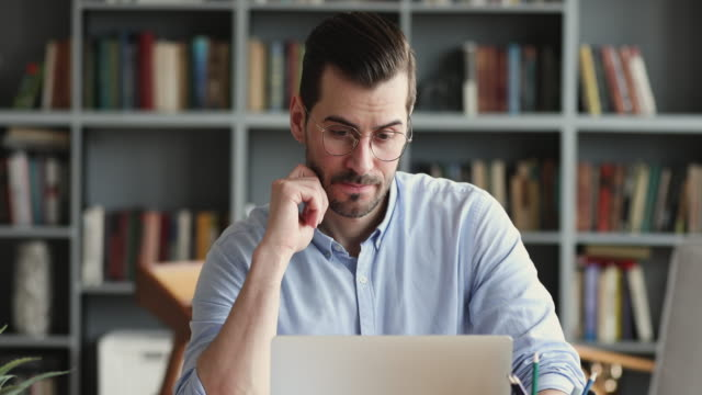thoughtful business man thinking of problem solution working on laptop - professione finanziaria video stock e b–roll