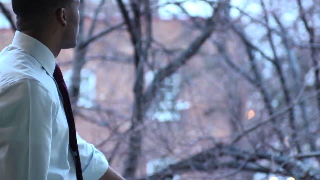 Thoughtful Businessman Looks out Window - MCU video