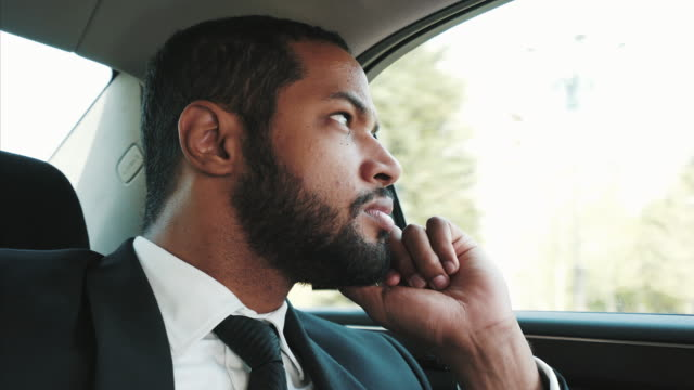Thoughtful businessman traveling by car. Young pensive businessman traveling through city streets by car. He must find a solution for his business or personal problems. eastern europe stock videos & royalty-free footage