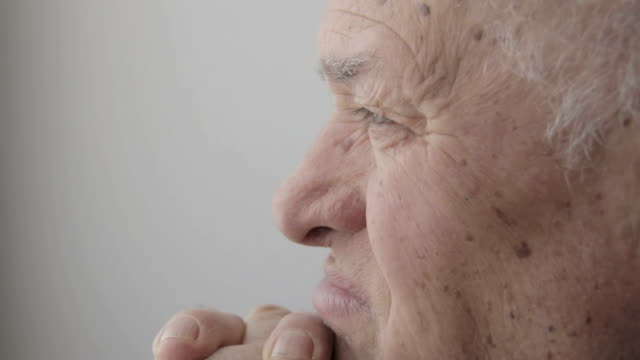 thoughtful elderly man sitting pensive and depressed video