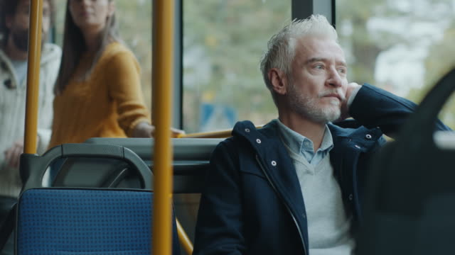Video Thoughtful mature men in the bus