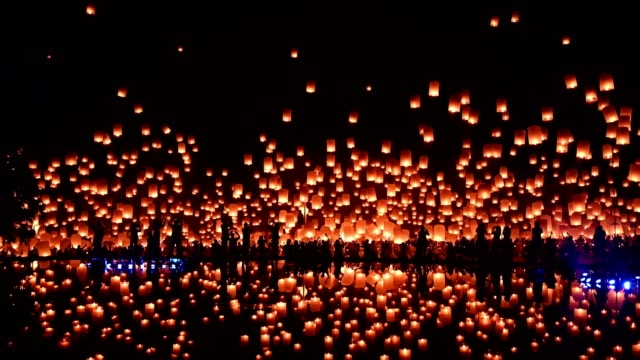 thousands of floating fire paper lanterns in the night sky with reflection in the pool at yee peng festival. Loy Krathong celebration at Sansai, Maejo university, Chiangmai, Thailand Keywords language: English Yee Peng Festival in Chiang Mai is celebrated on the full moon of the twelfth lunar month ever year. lantern stock videos & royalty-free footage
