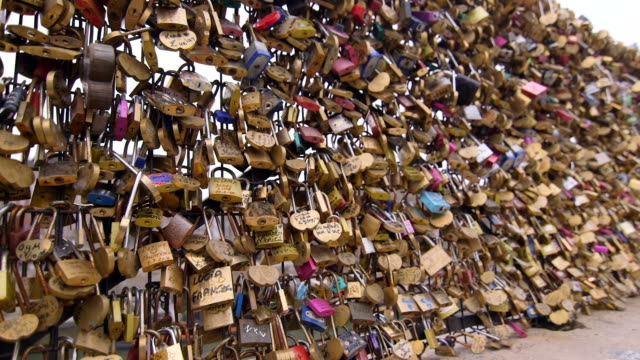 thousands of locks on fence - paris fashion stock videos and b-roll footage