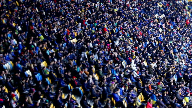 Thousands of people watching football match at stadium, big sporting event video