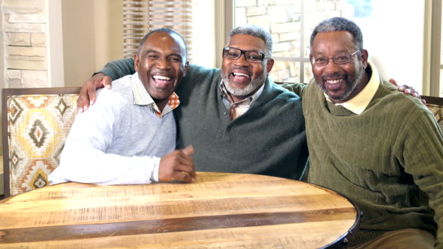 vídeos de stock e filmes b-roll de three african-american men smiling at the camera - 55 59 anos