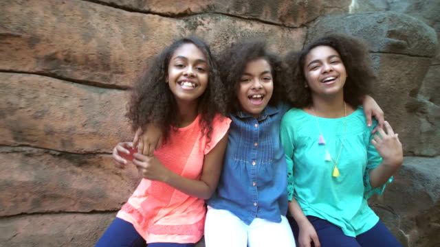 three african-american sisters having together, laughing - fianco a fianco video stock e b–roll