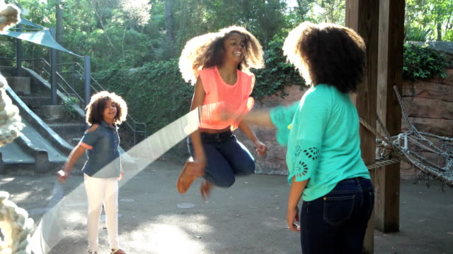 three african-american sisters jumping rope - preadolescente video stock e b–roll