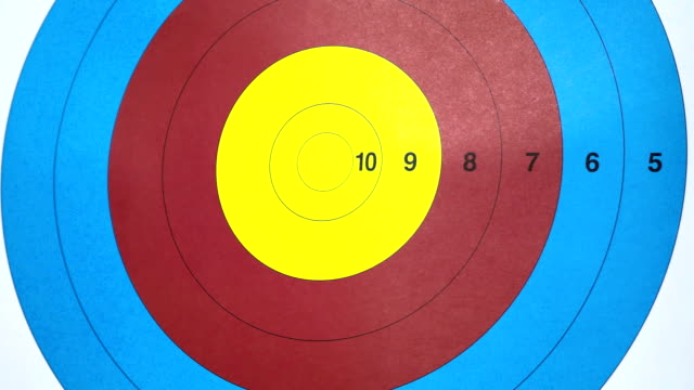 Three arrows hits on target. Ten. Close up archery video