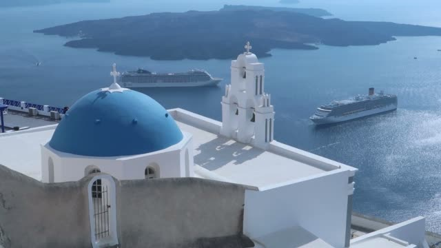 three bells of fira - amazing view on santorini island, greece - fire filmów i materiałów b-roll