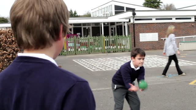Three Boys Playing Catch In School Playground video