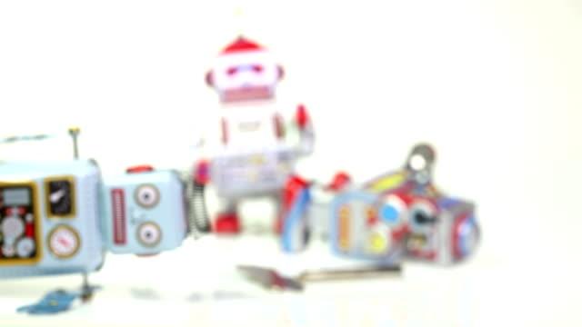 Three broken toy robots video