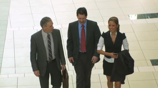 Three business poeple walk video