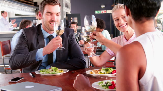 Three Businesspeople Having Lunch In Restaurant video