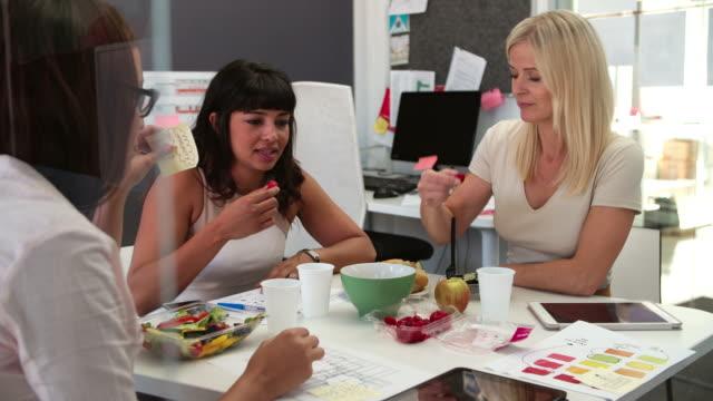Three Businesswomen Having Working Lunch In Office video