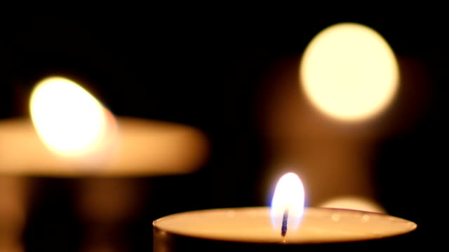Three Candle light on black background video