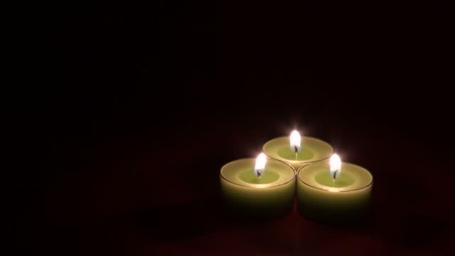 vídeos de stock e filmes b-roll de três velas em blackness - três objetos