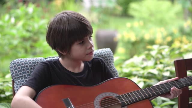 three children skills development activities education boy playing guitar