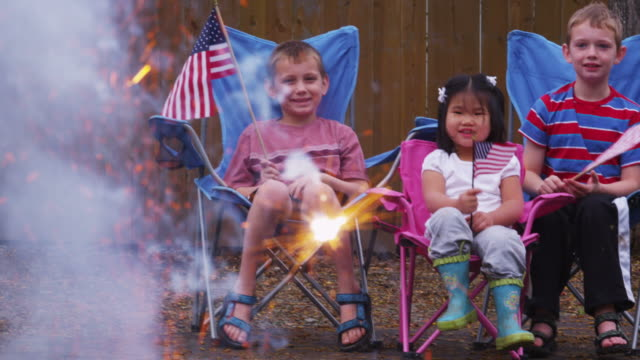 Three children watching fireworks and celebrating 4th of July  fourth of july videos stock videos & royalty-free footage