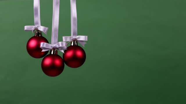 Three Christmas decoration balls falling one by one Three Christmas decoration balls falling one by one. They represent three wishes or gifts for a special day christmas ornament stock videos & royalty-free footage