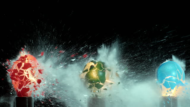 SLO MO three colored light bulbs exploding video