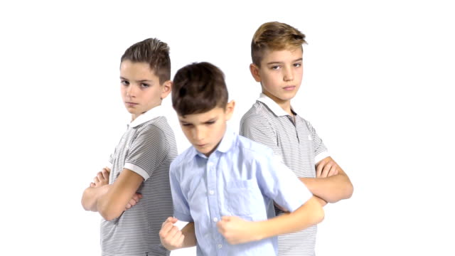 Three cool brothers at white background video