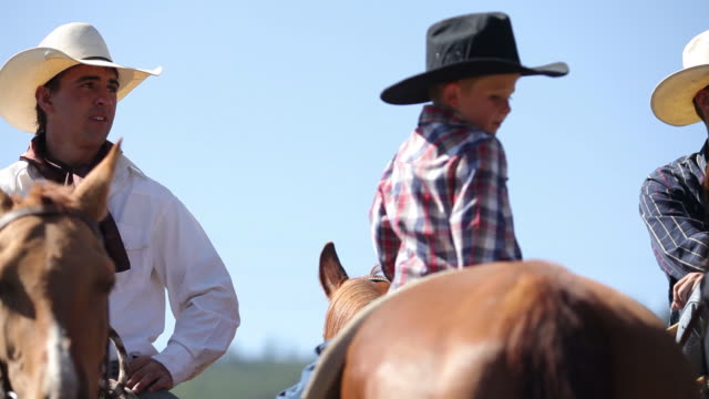 Three cowboys saddle up video