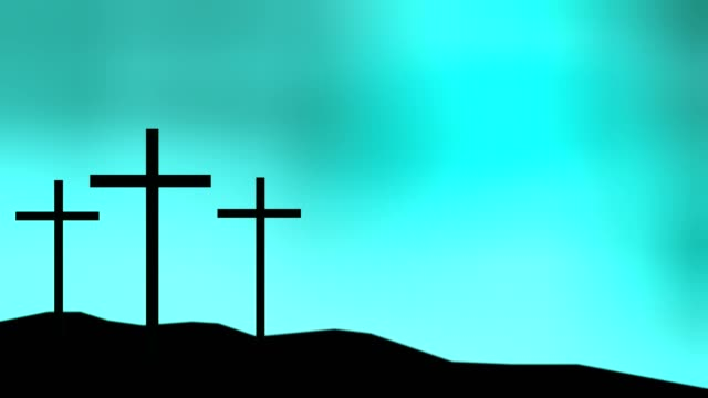 Three crosses sitting on a hill with a blue sky background video