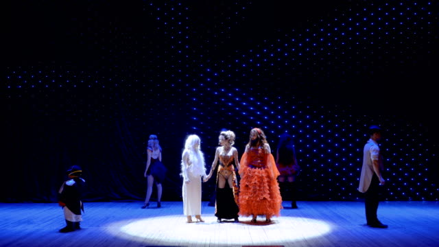 Three different girls sing song together on the stage in theatre Beautiful albino girl, bearded girl and fire-girl sings sad song about their hard lives in the society. People with greasepaint and wearing scenic costumes are singing on the stage in theatre. Modern performance with crazy heroes. actor stock videos & royalty-free footage