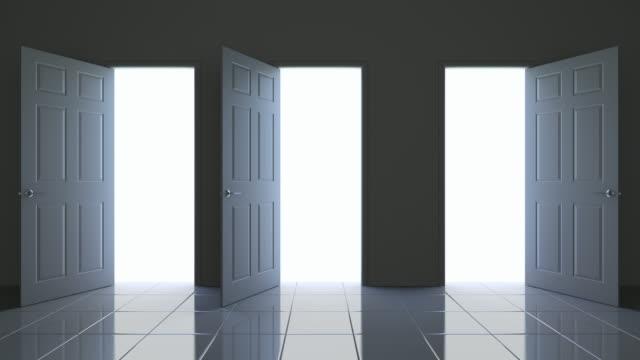 stockvideo's en b-roll-footage met drie deuren openen - drie personen