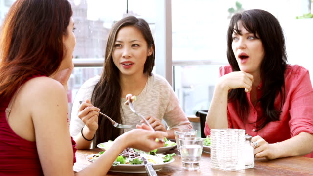 Three Female Friends Enjoying Lunch At Rooftop Restaurant video