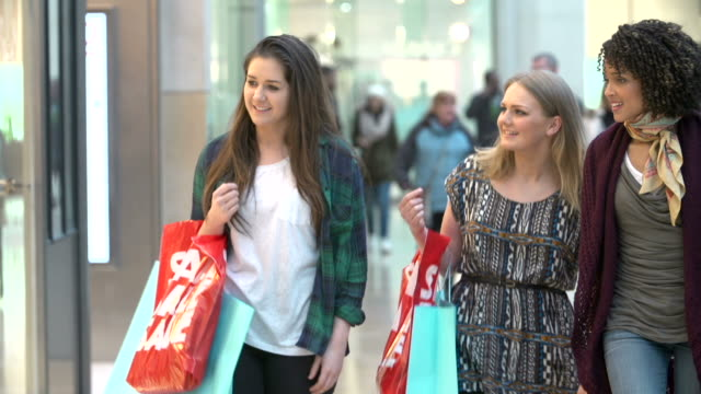Three Female Friends Shopping In Mall Together video